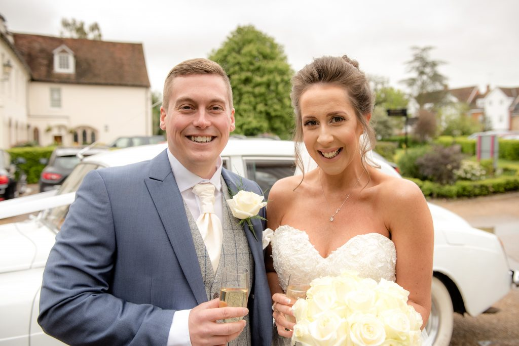 The bride and groom outside of the ware priory