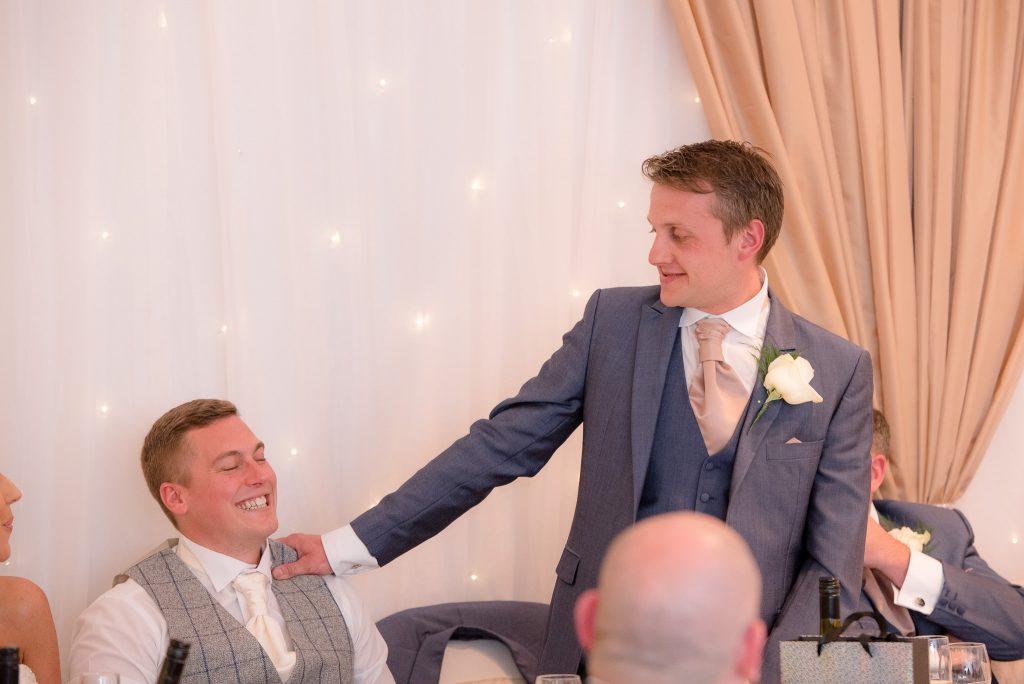 The best man teases the groom