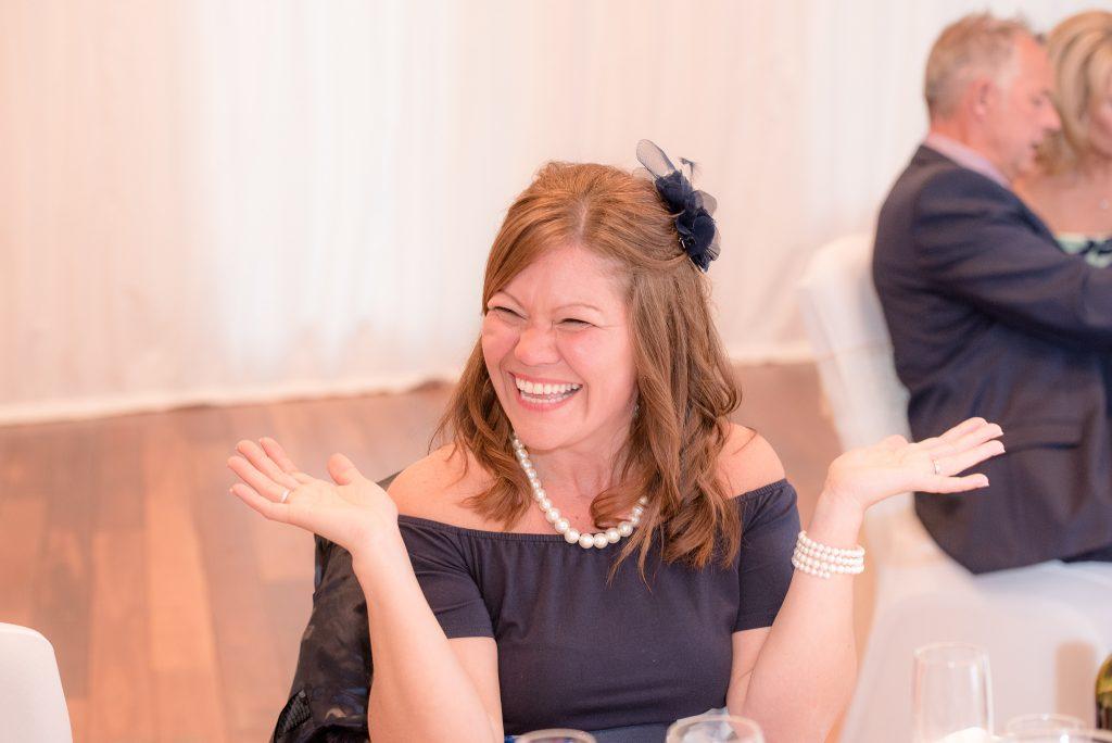 A guest applauds the wedding speeches