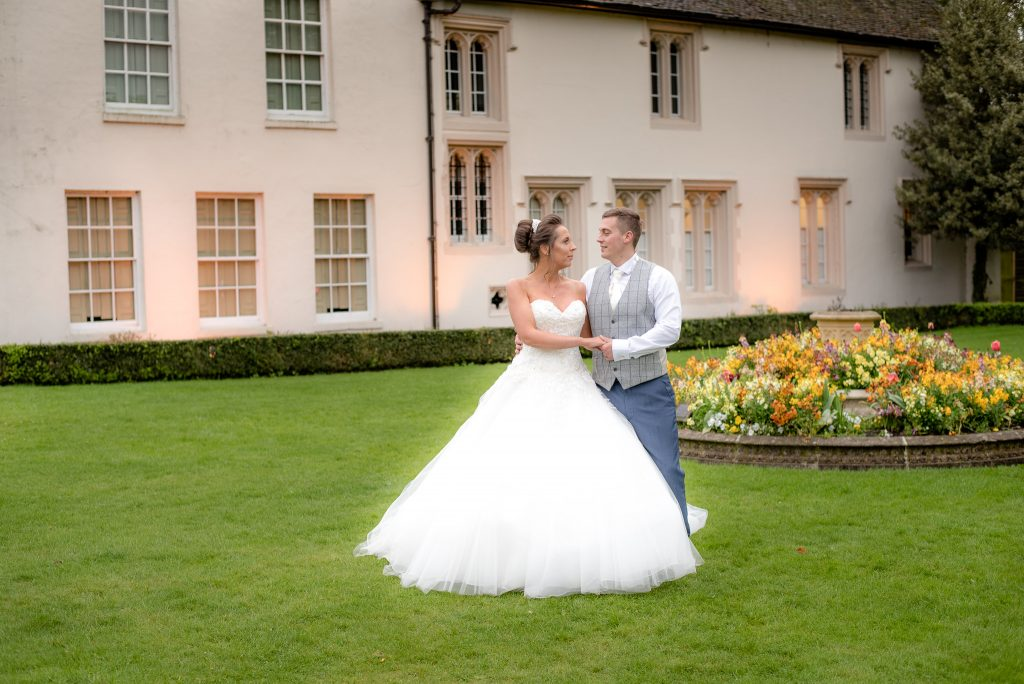 The bride and groom outside ware priory