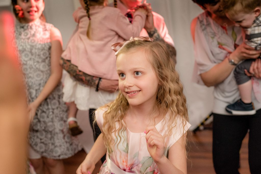 A young girl dances to the music