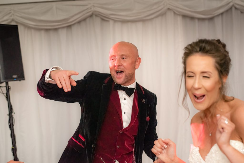 Guests dance together at ware priory