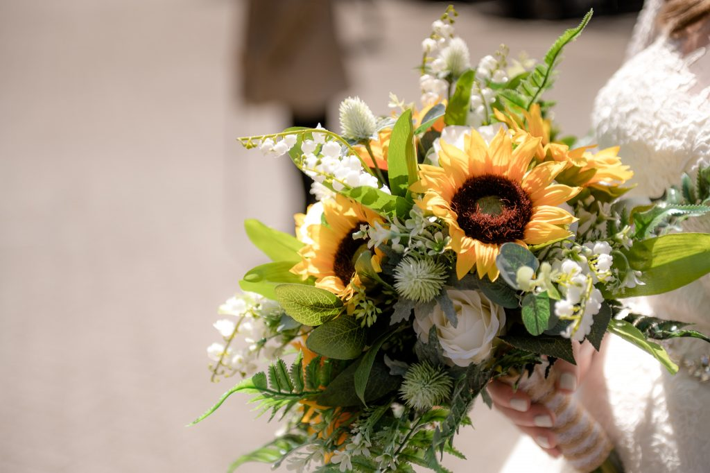 the brides' bouquet with a mix of orange, green and white