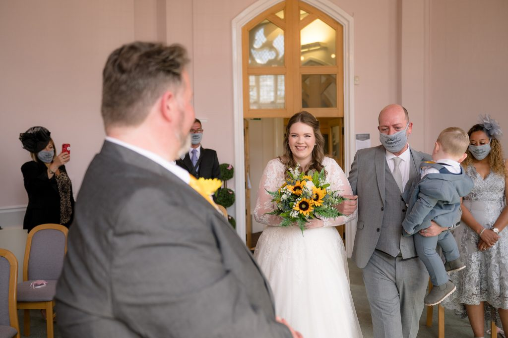 The bride arrives in the octagonal room