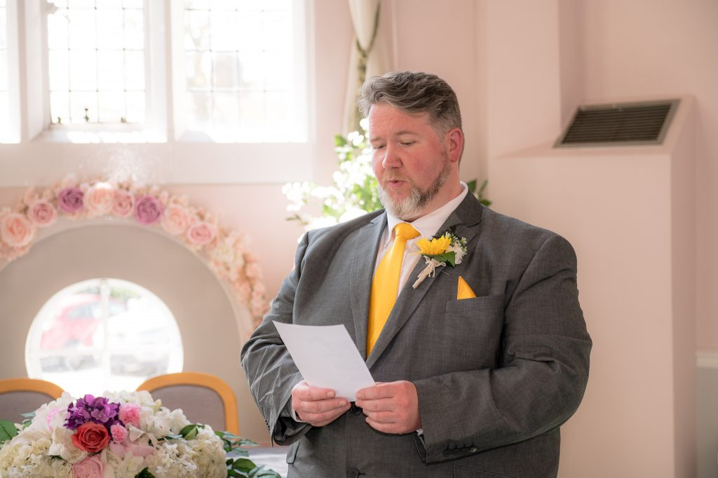 The groom reads out his vows