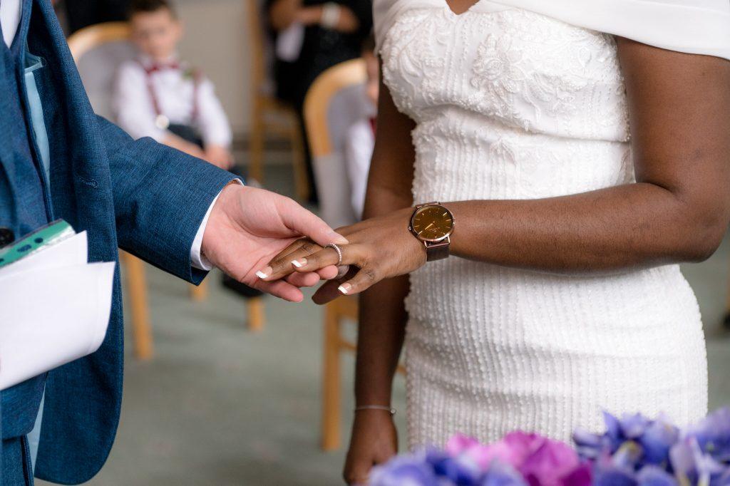 The bride and groom exchange wedding rings