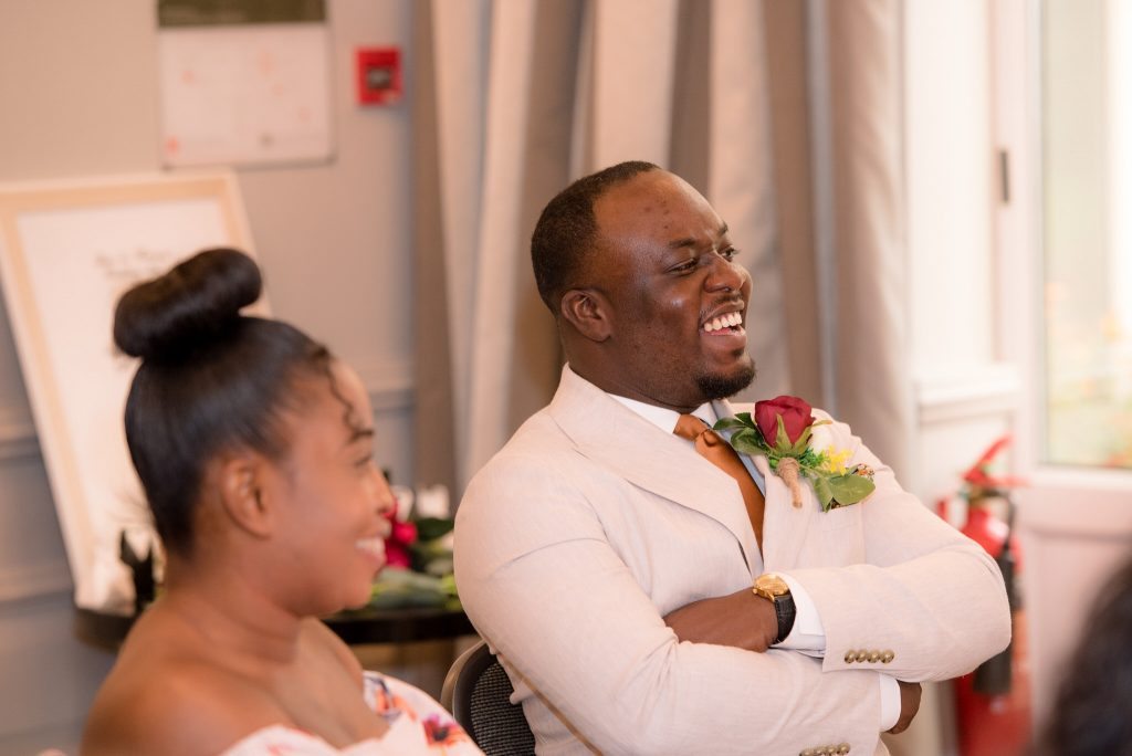 Guests laugh at the speeches
