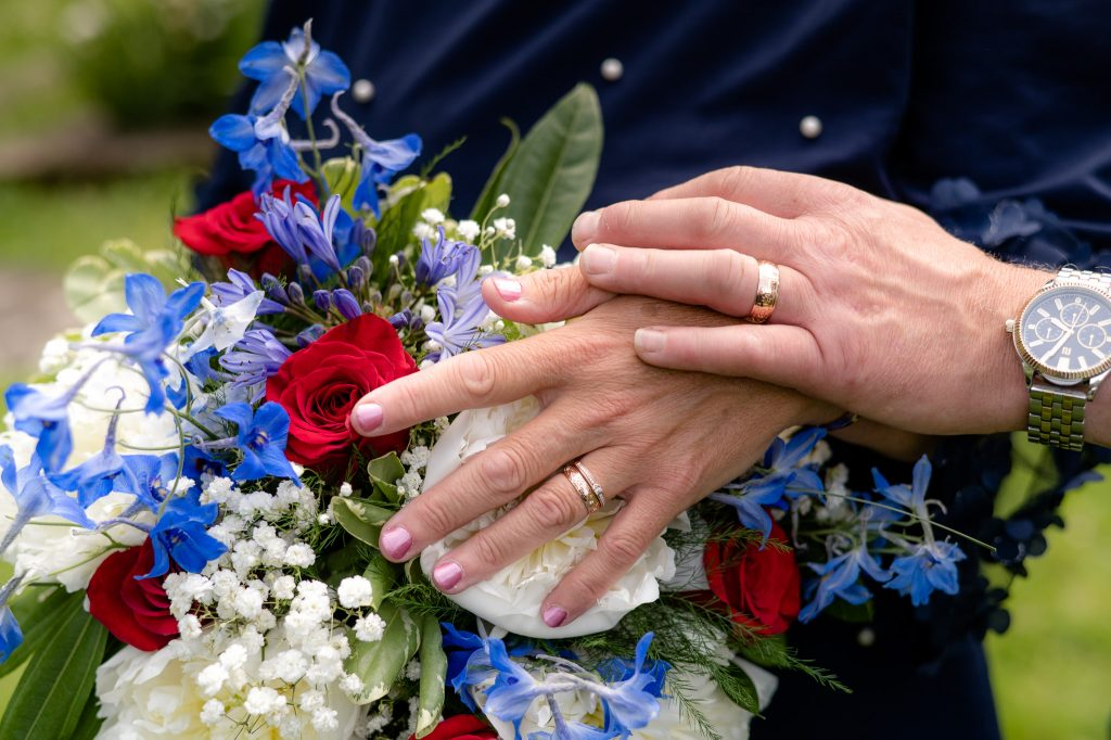 The bridal bouquet and wedding rings