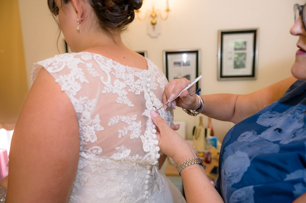 the buttoning of the wedding dress