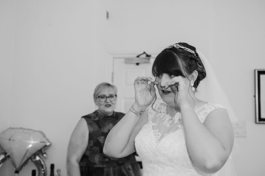 the bride sees herself in her wedding dress for the first time