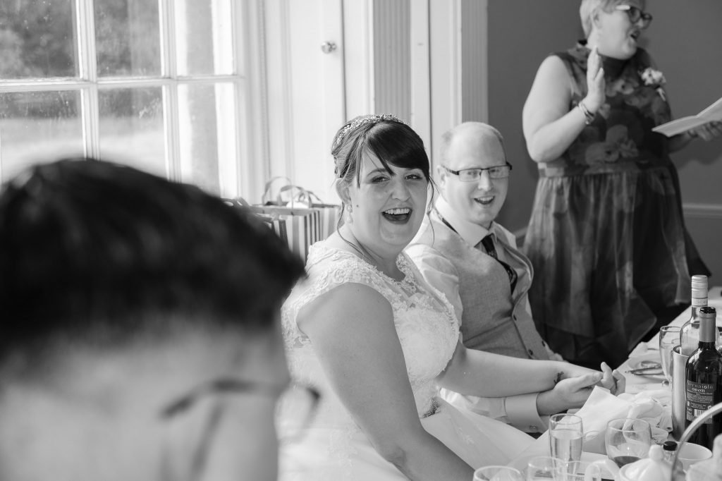 the bride laughs at the speech