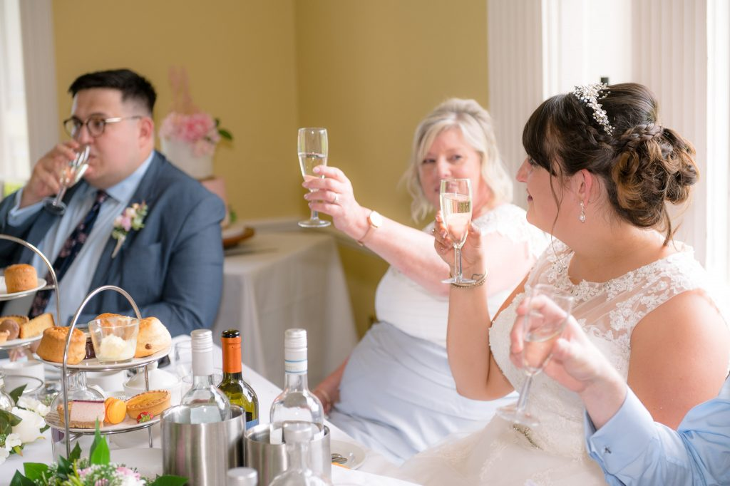 the family toast the bride and groom